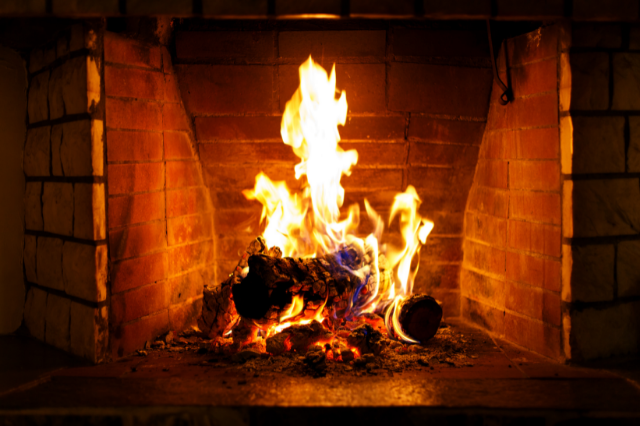 A fireplace with an active fire burning
