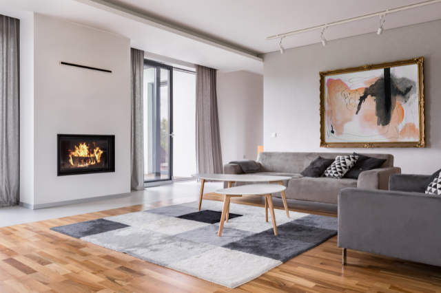 A modern living room with a fireplace built into the wall.